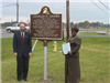 Carolyn Brown standing with the historical marker