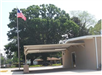 Side view of covered parking area and United States flag
