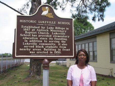 Woman standing in front of the historical marker