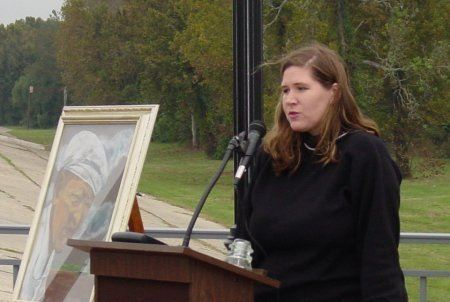 Woman speaking about the painting of George West