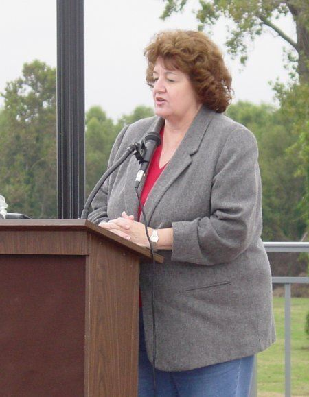 Woman talking at the podium during the dedication